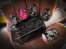 Nail Stamp Art. Black base with white stamping. Pink or glitter accent finger.