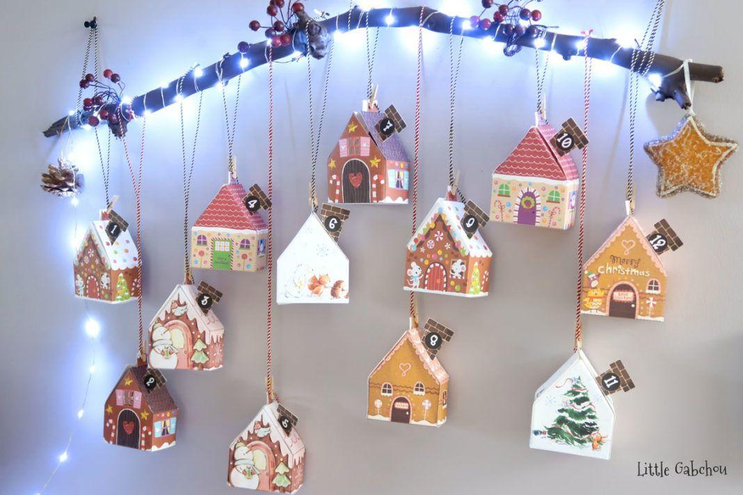 (DIY de Noël) Le calendrier de l'avent astucieux #calendrierdelaventfaitmaisontissu calendrier de l'avent fait maison avec des petites maisons #calendrierdelaventfaitmaisonfacile