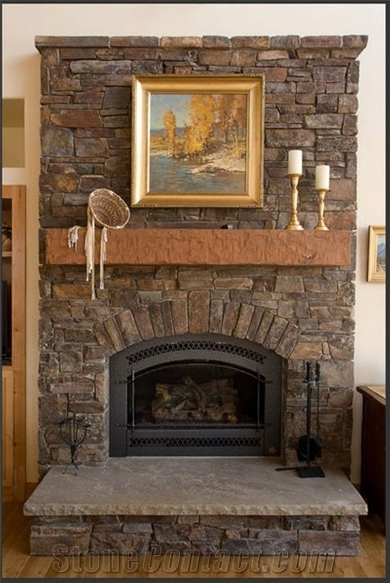 Rustic stone fireplace with brown mantel shelf and grey - Fireplace hearth stone ideas ...