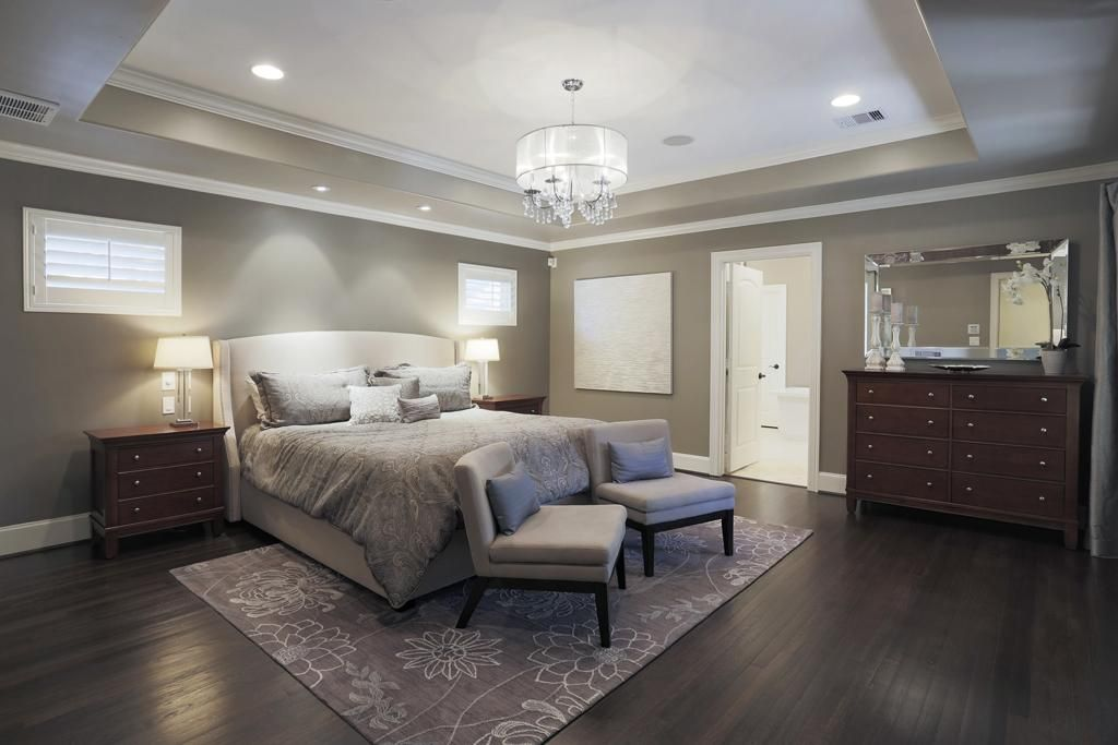 Gorgeous Master Suite Downstairs With Tray Ceiling Recessed Lighting Gleaming Hardwood Floors