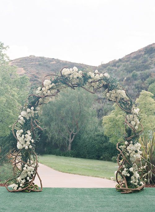 Glamorous Backyard Wedding in Calabasas, California, Greenery and Floral Ceremony Arch | Brides.com
