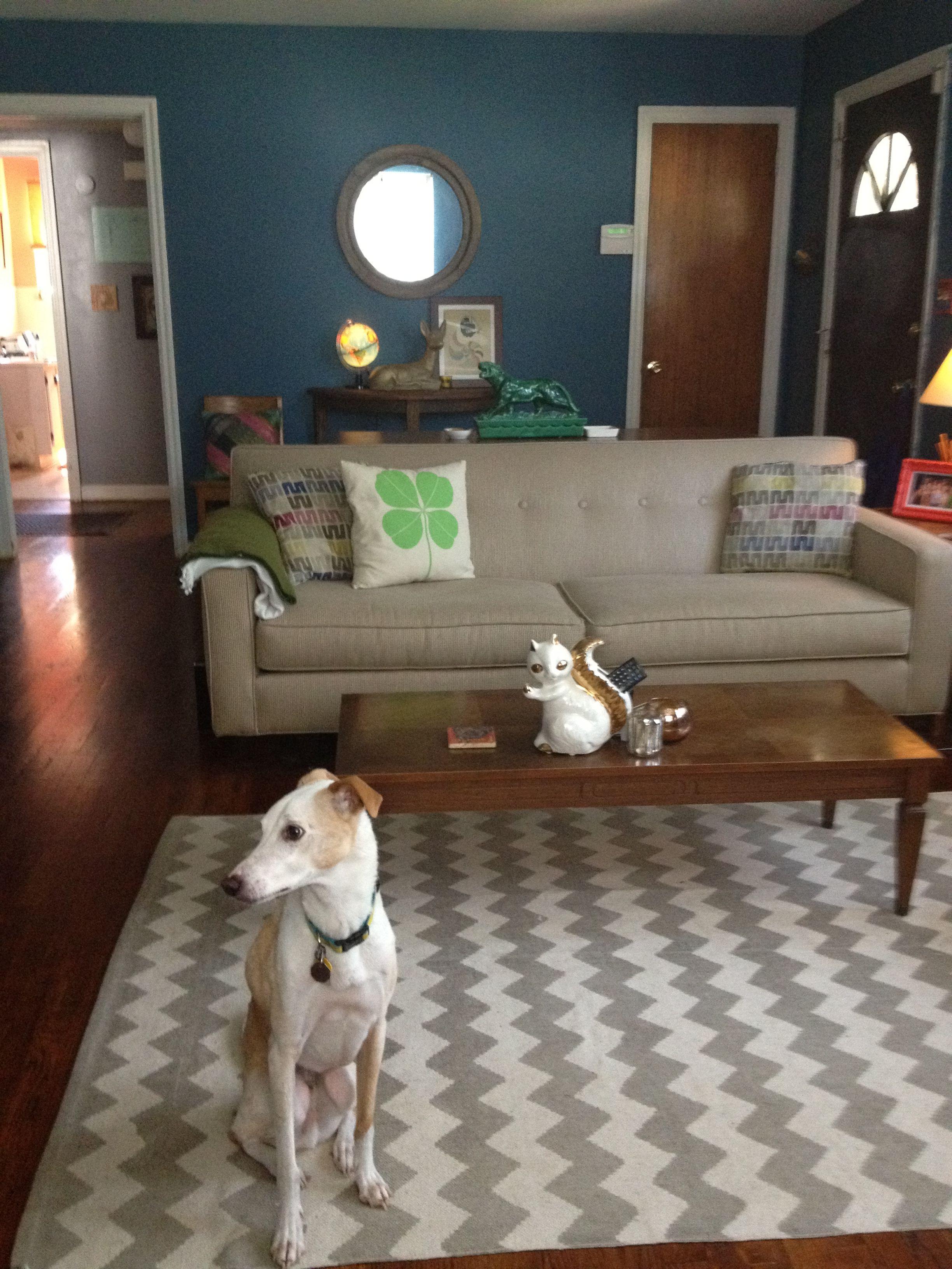 sofa. rug. back table. mirror.