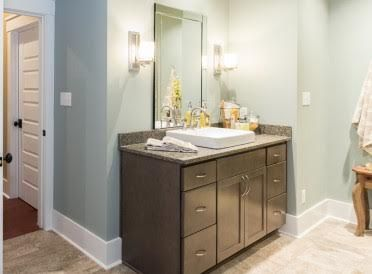 master bath vanity in homecrest cabinetry sedona maple anchor stain countertop is cambria bradford