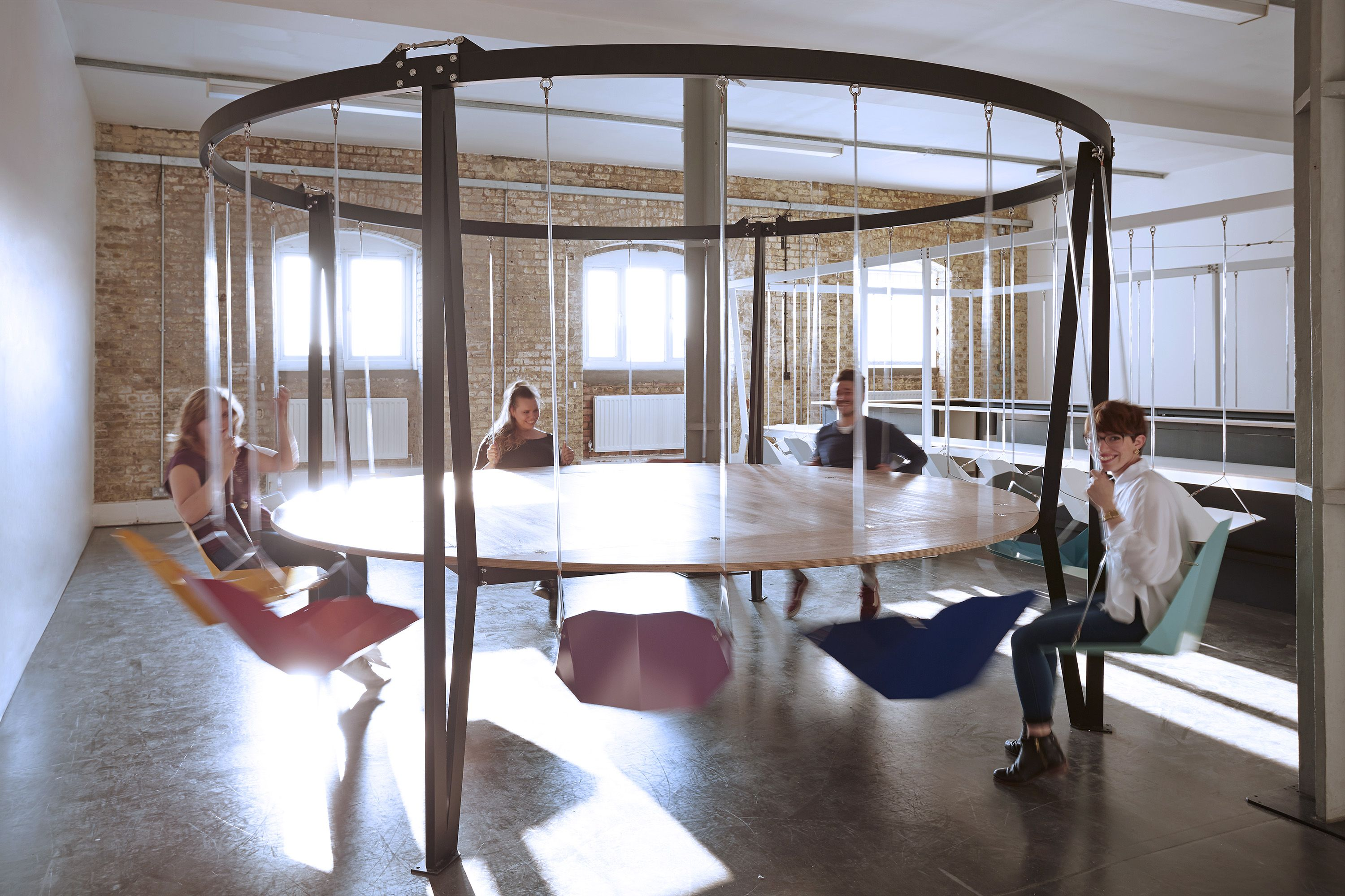 Duffy London Team Having Fun On The King Arthur Round Swing Table 12 Seats