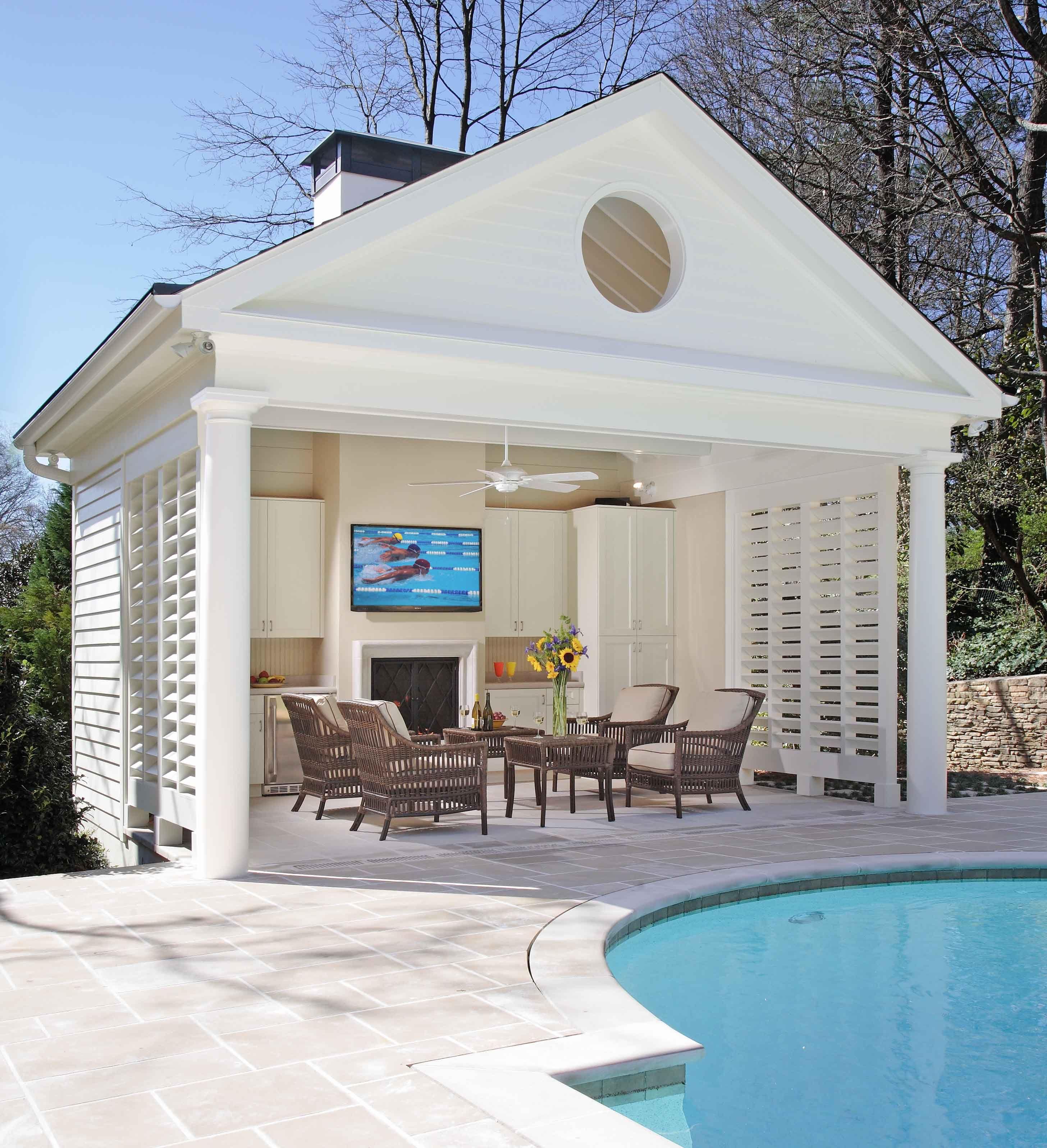 Buckhead pool and cabana with fireplace bahamian shutters