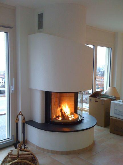 Des exemples de réalisations de cheminées rondes par Art  Feu SA - faire sa maison en 3d