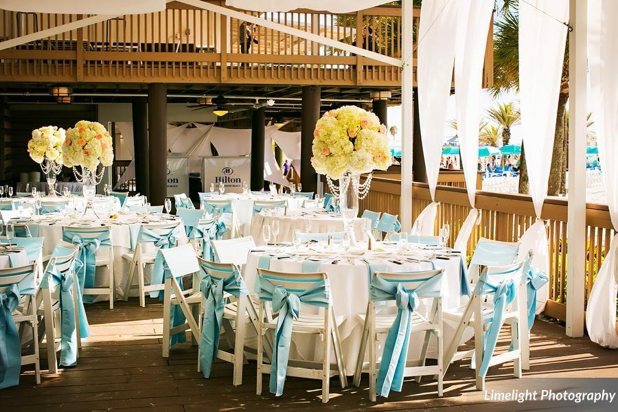 Hilton Clearwater Beach Florida Wedding Destination Outdoor Reception Hydrangea Centerpieces Blue Sashes Arch