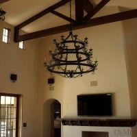 Authentic scrolled chandeliers hang in this classic Spanish living room.