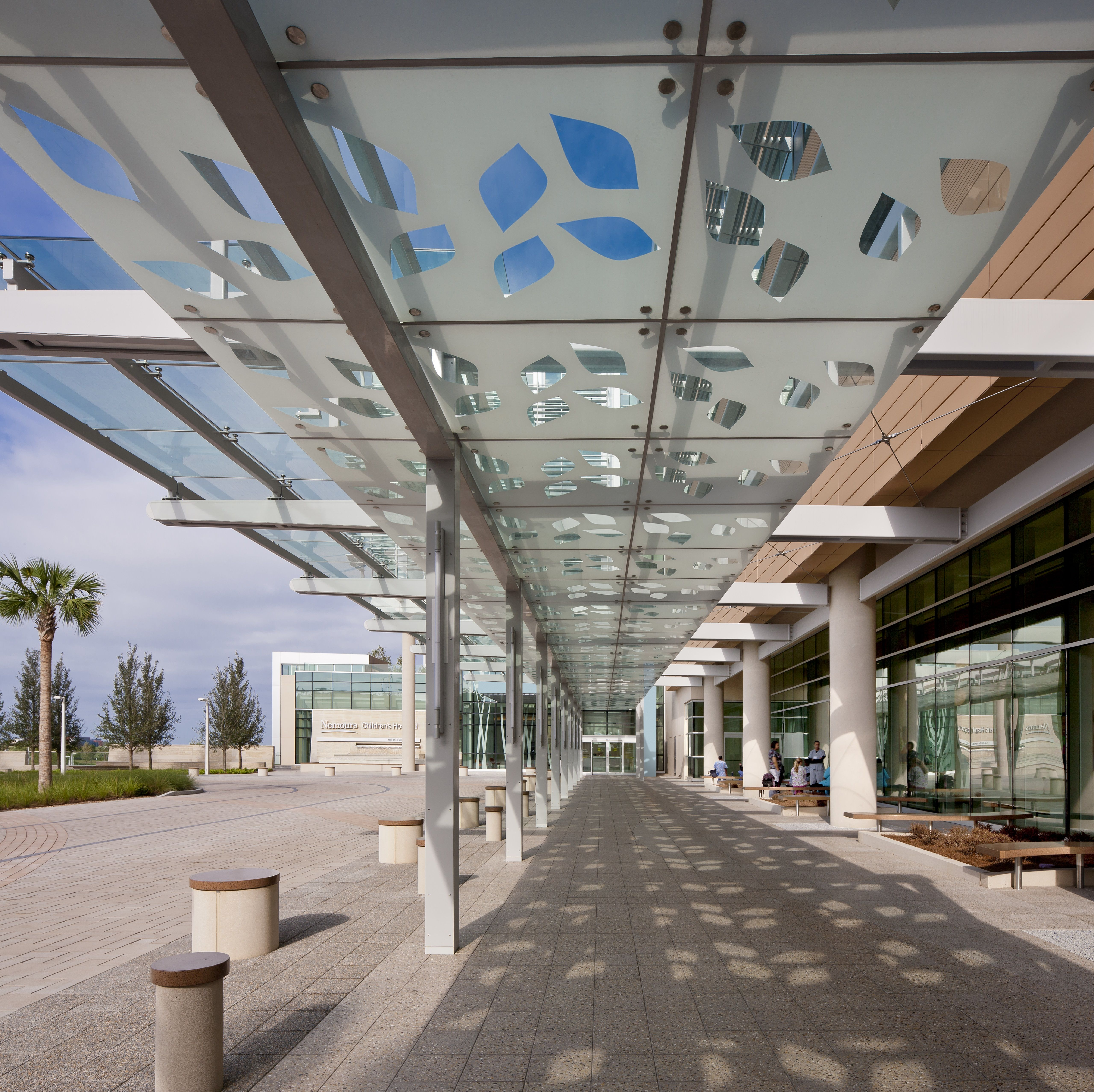 The car pick-up/drop-off zone at the main entrance provides a cover from the elements by using fritted glass with a leaf-shaped pattern. The design is repeated in larger dimensions on floors and ceilings throughout the hospital. Nemours Children's Hospital. Jonathan Hillyer/HillyerPhoto.com.