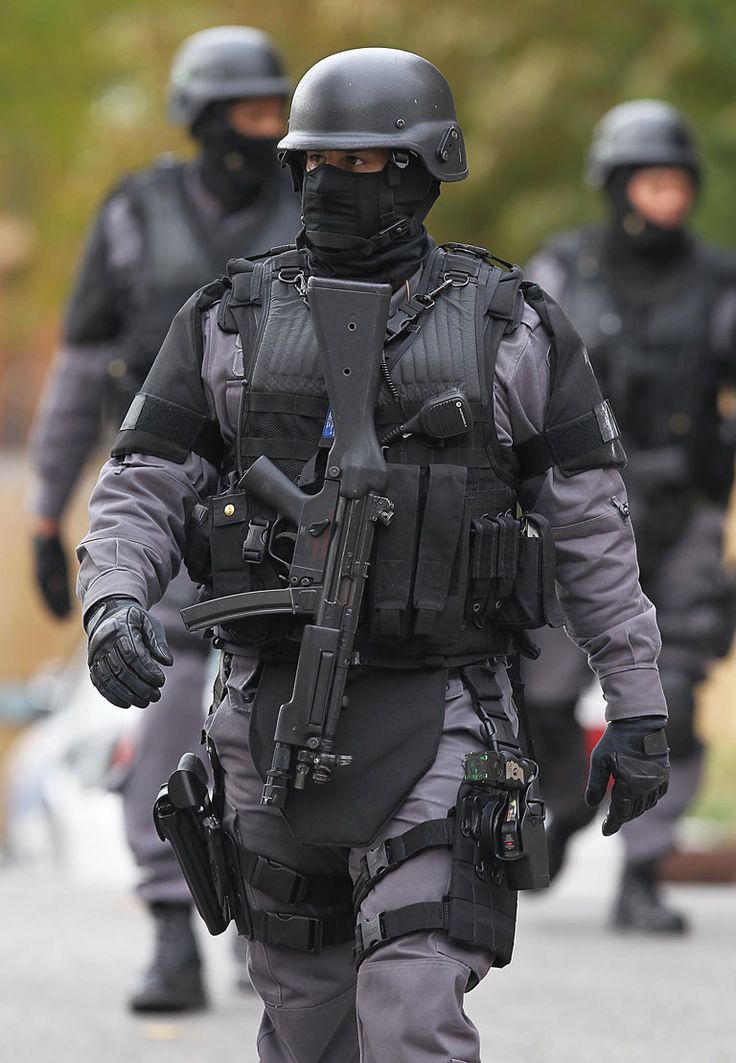 SWAT Officer. I\'m going to be using the vest this officer is wearing ...