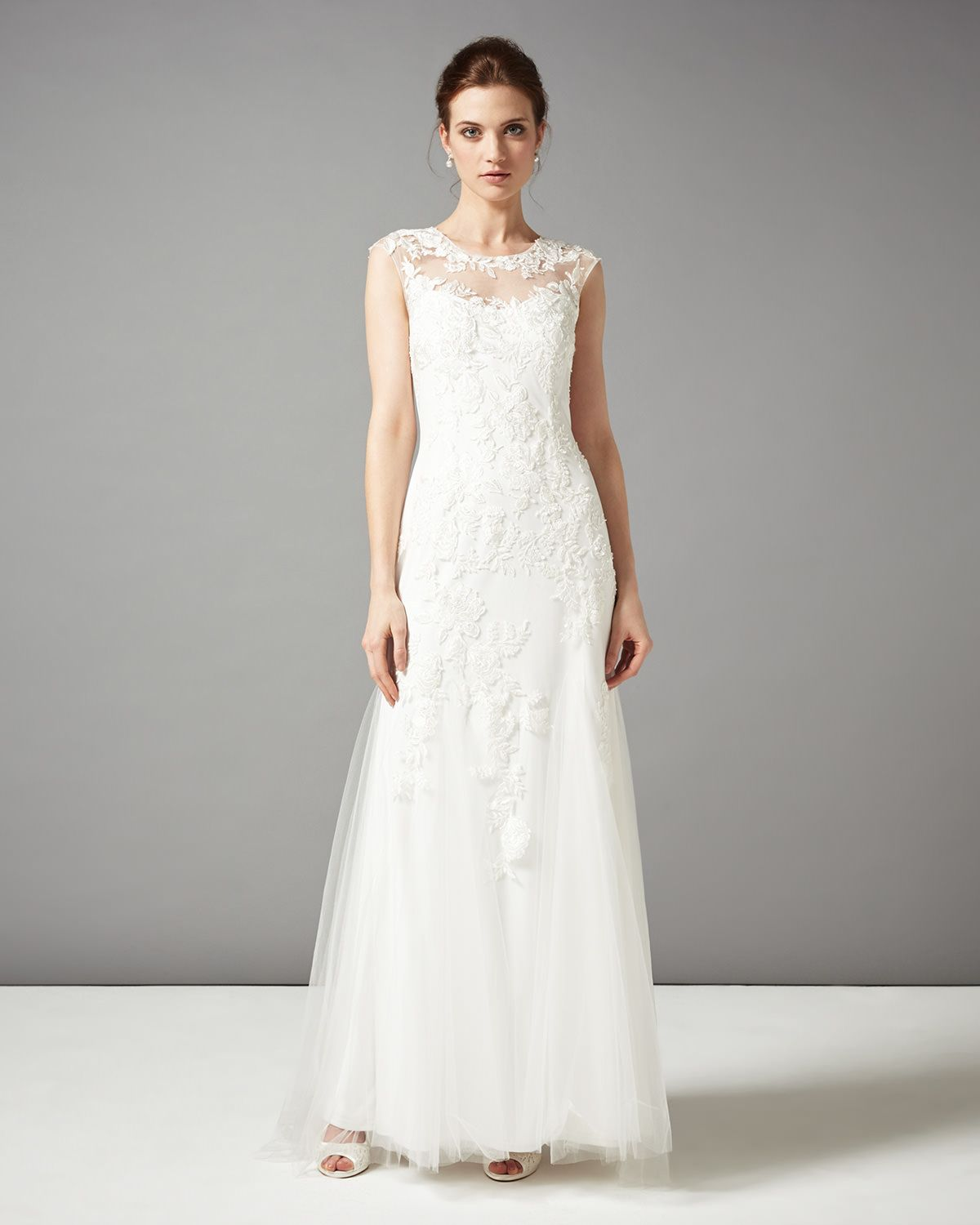 Stunning wedding dresses  A stunning wedding dress featuring beautiful floral embroidered mesh