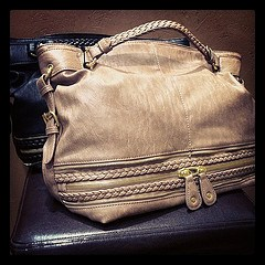 large purse with braided detail  via boutiika.com