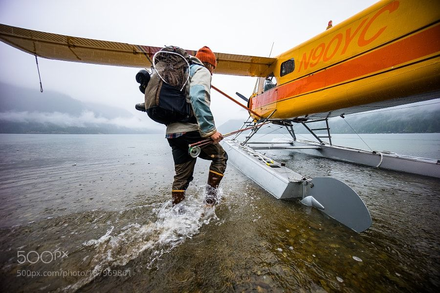 http://500px.com/photo/187969861 PNW Recipe for adventure by ChrisBurkard -The Pacific Northwest is a place you can spend months exploring and still not see everything there is to see. The plane is fueled bags are packed batteries are charged and now the adventure begins. Alder Trees Salmonberries Bald Eagles and fishing for Rainbow Trout mix together for a PNW recipe.. Tags: TravelPhotographyFishingPlaneAdventureChris BurkardPacific NorthwestGoal ZeroReomte