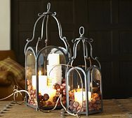 Fall decorating. Pottery Barn lanterns filled with candles and mini pumpkins.
