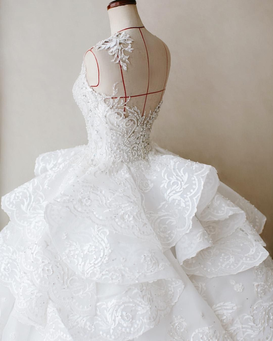 Back detail wedding dress  Melta Tan full ruffle tattoo back detail wedding gown  Brids