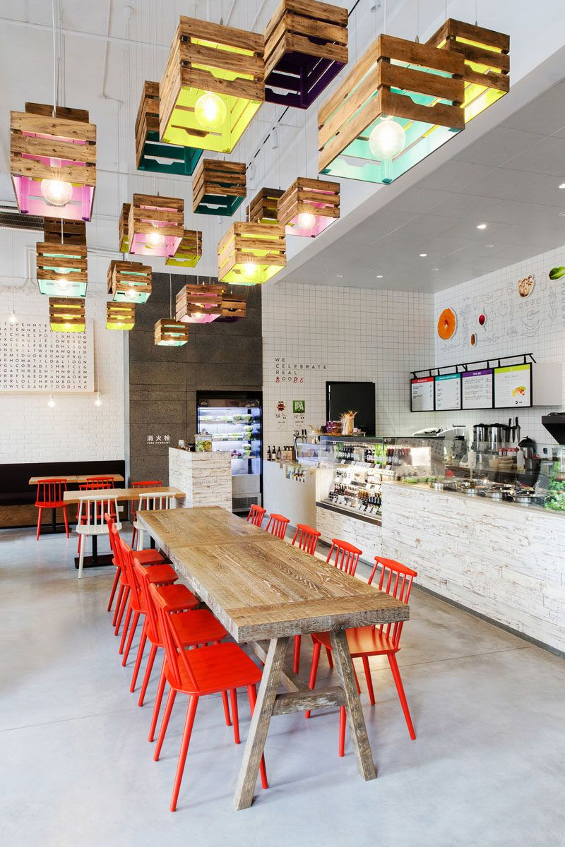lighting design idea wood crates painted on the inside act as shades in this restaurant