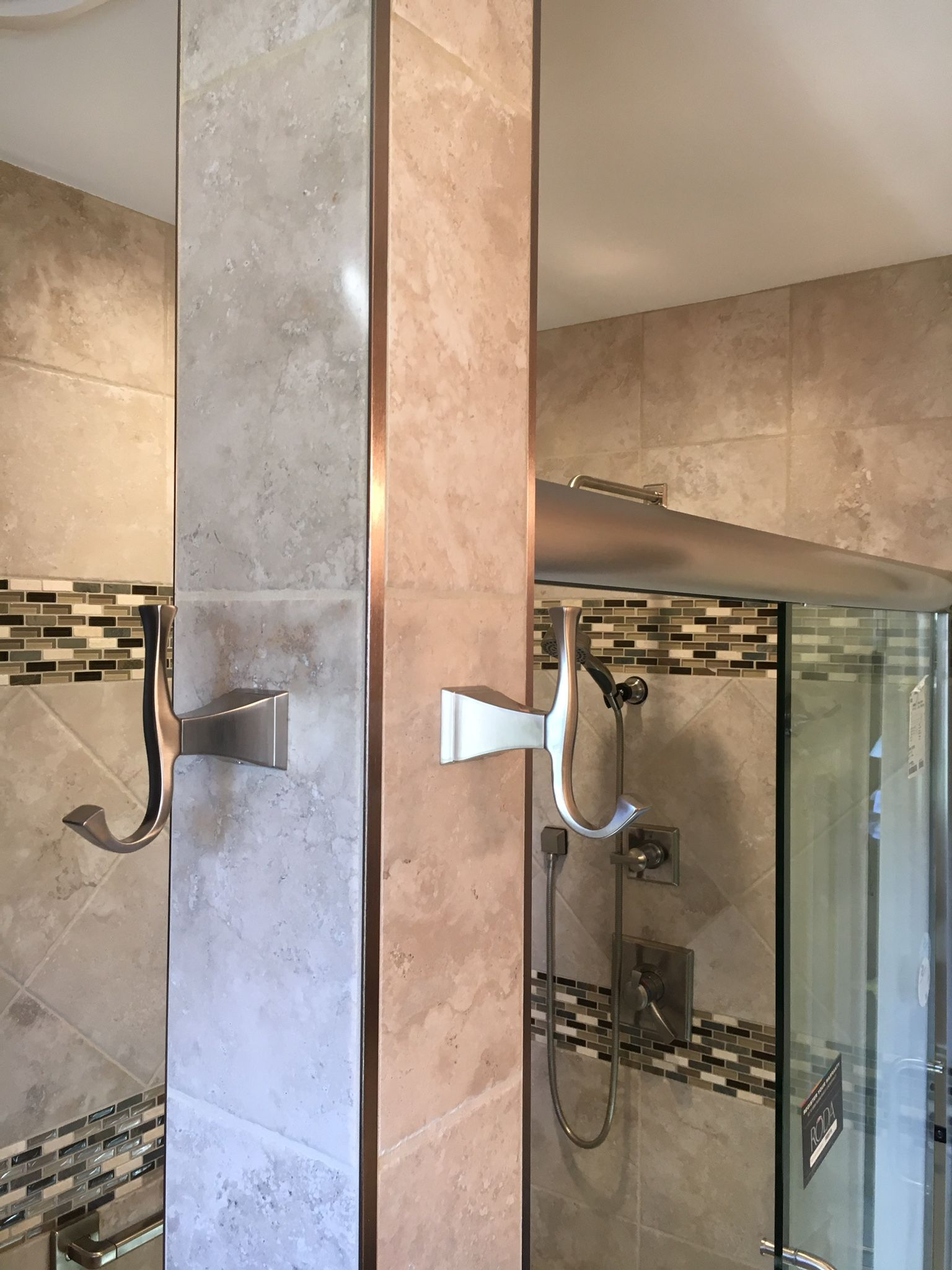 stainless steel bathroom accents with metal schluter strips to edge out tile tan tile neutral. Black Bedroom Furniture Sets. Home Design Ideas