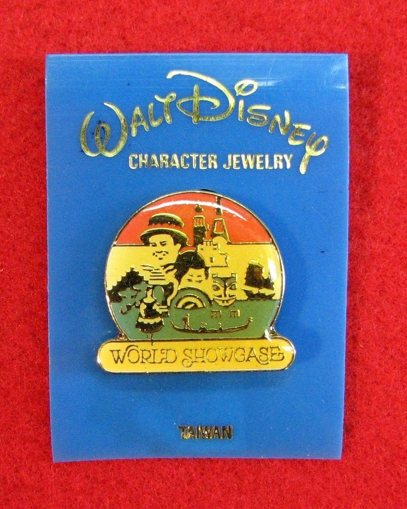 VINTAGE DISNEYLAND WORLD SHOWCASE EPCOT ENAMEL PIN ON ORIGINAL CARD!