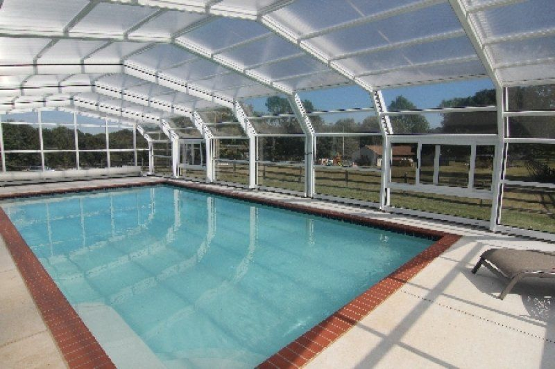 Skyesville Pool Our Libart Customer Tammy Had A Growing Desire For Year Round Use Of Her Pool Area And Increasing Arthrit Pool Cover Pool Enclosures Cool Pools