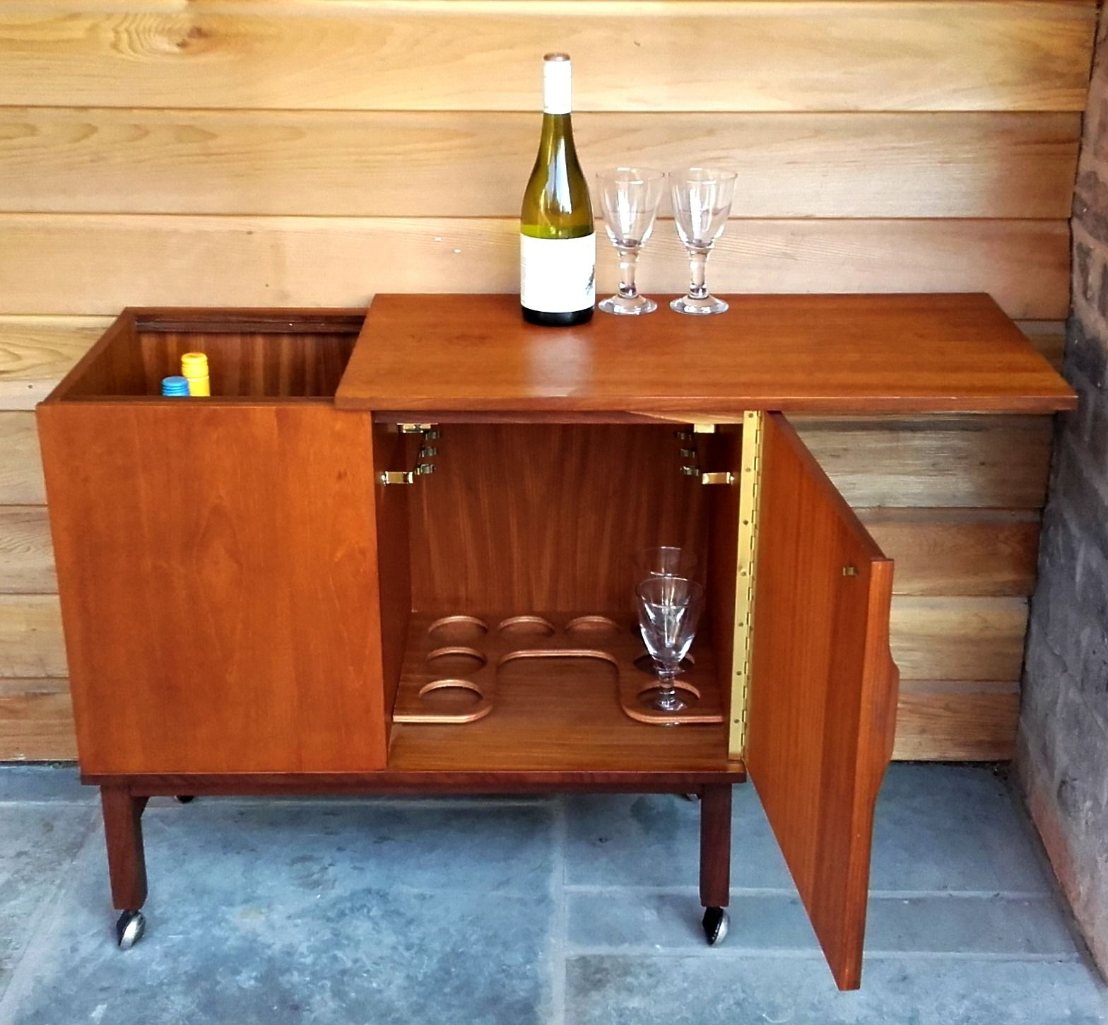This Lovely Teak Drinks Cabinet Has A Party Piece The Top Slides Open Revealing Metal Sleeved Stor Drinks Cabinet Mid Century Furniture Contemporary Interior