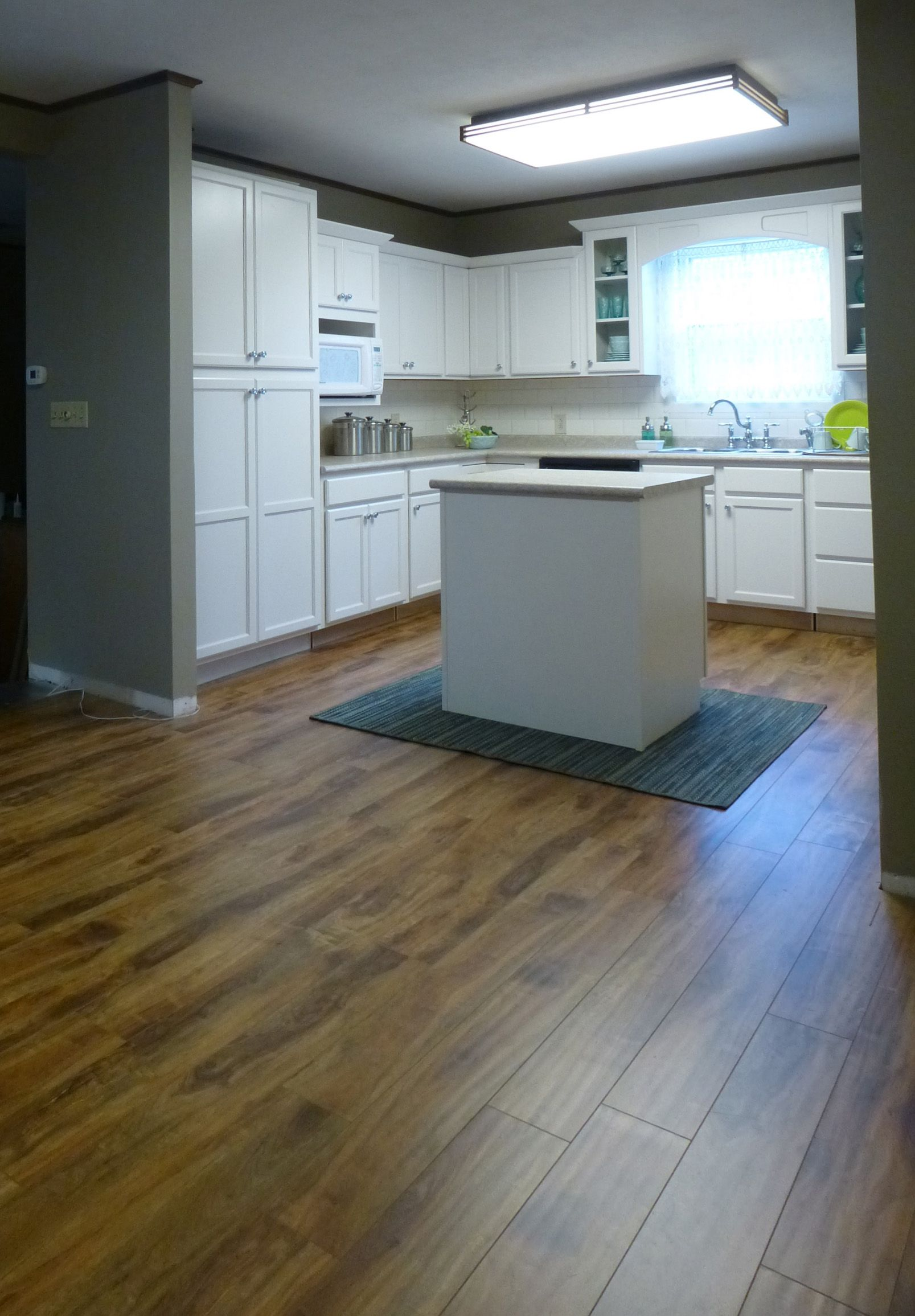 "Casabella laminate flooring Country Manor series in ""Chestnut"