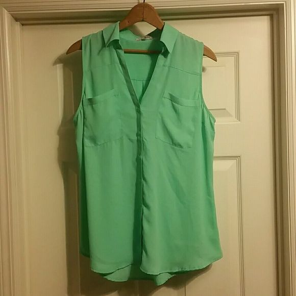 EXPRESS Portifino Shirt Size L Like New Never worn, but the tags have been removed. EXPRESS Portifino Shirt Size large. Beautiful light green color. 100% polyester. Lightweight. Dressy or casual. Express Tops Blouses