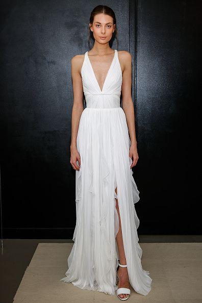 10 Beach Wedding Dresses You Can Buy Off The Rack Beachy Wedding Dress Wedding Dress Gallery Bridal Fashion Week