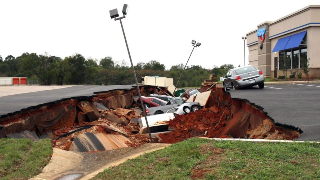 Ground swallows cars in Mississippi