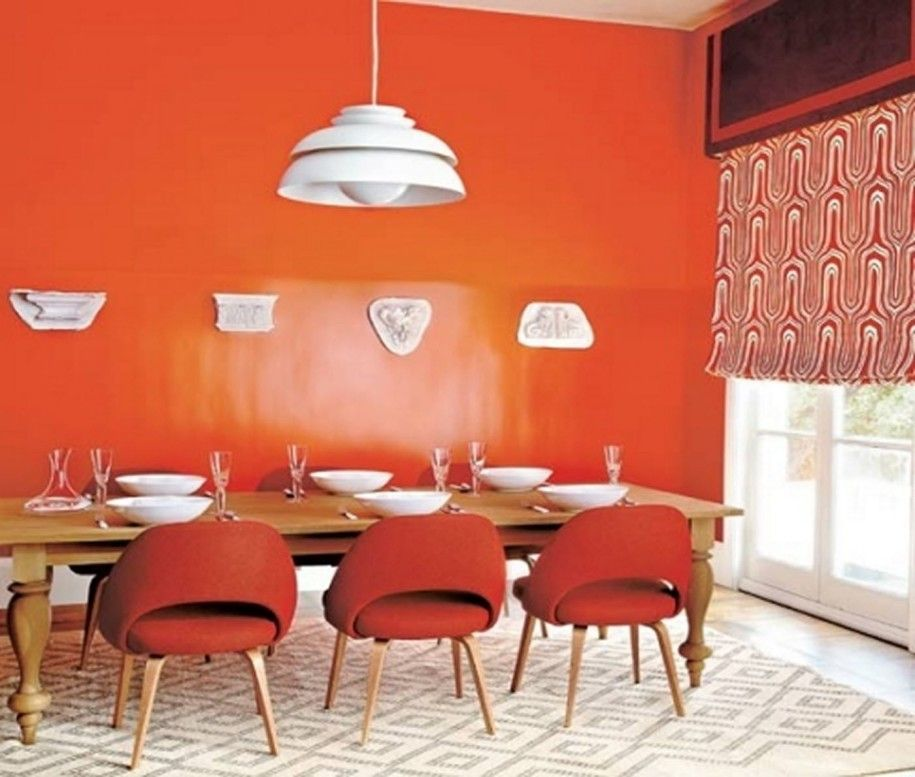 Contemporary Dining Room With Orange Wall Paint Red Chairs And Inspiration Orange Dining Room Table Decorating Design