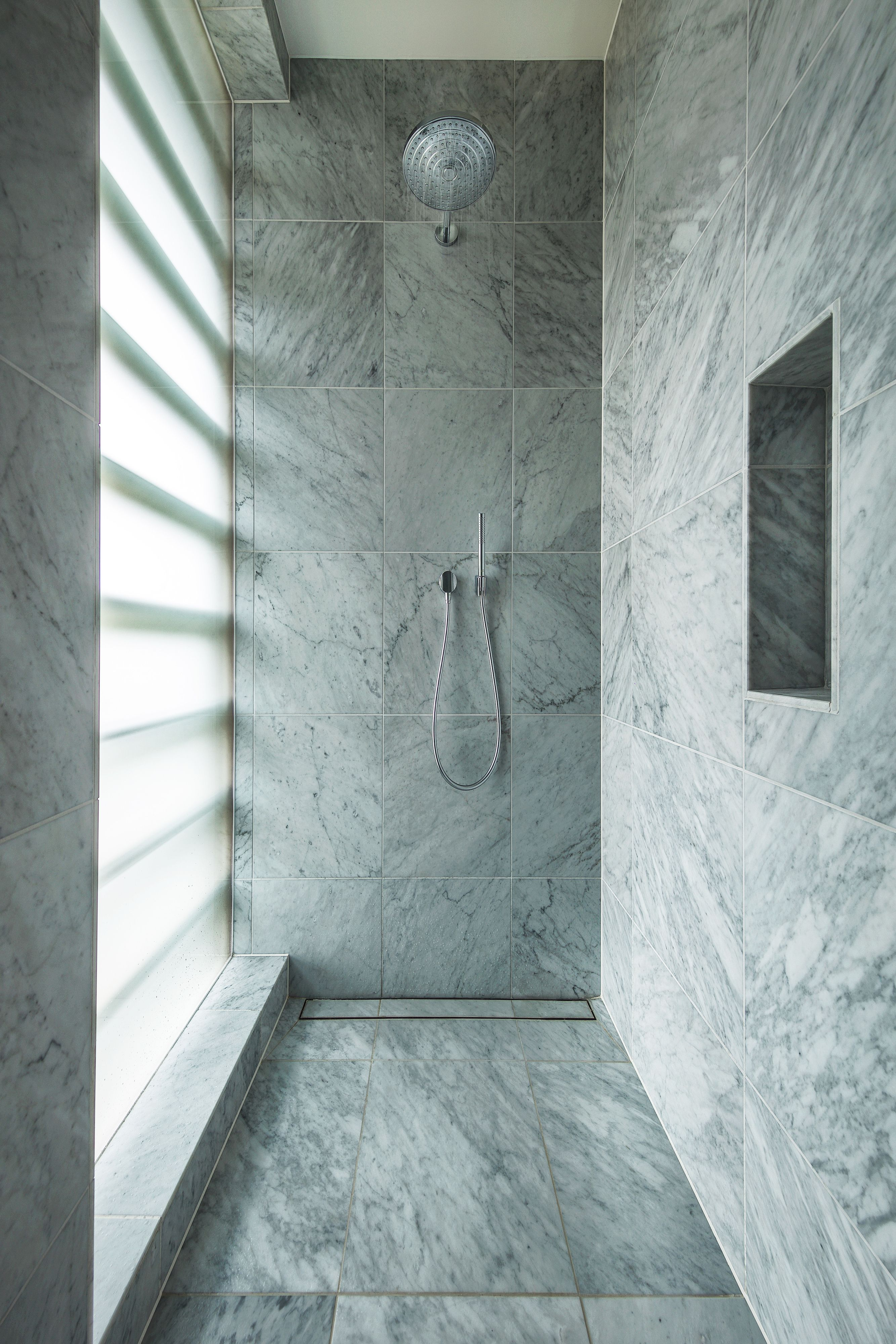 Contemporary minimalist marble walk-in shower. Sanitaryware by The ...