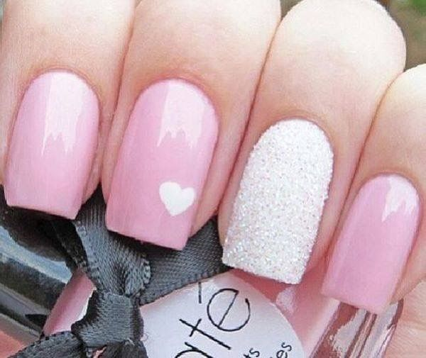 Light pink with a white heart and a white glittery accent nail