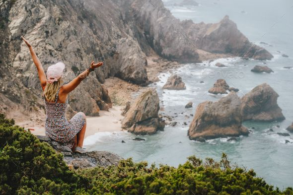 Happy tourist women enjoying epic Praia da Ursa Beach on morning. Surreal scenery of Sintra by Shunga_Shanga. Happy tourist women enjoying epic Praia da Ursa Beach on morning. Surreal scenery of Sintra, Portugal. Atlantic Ocean... #AD #Praia, #epic, #Ursa, #da