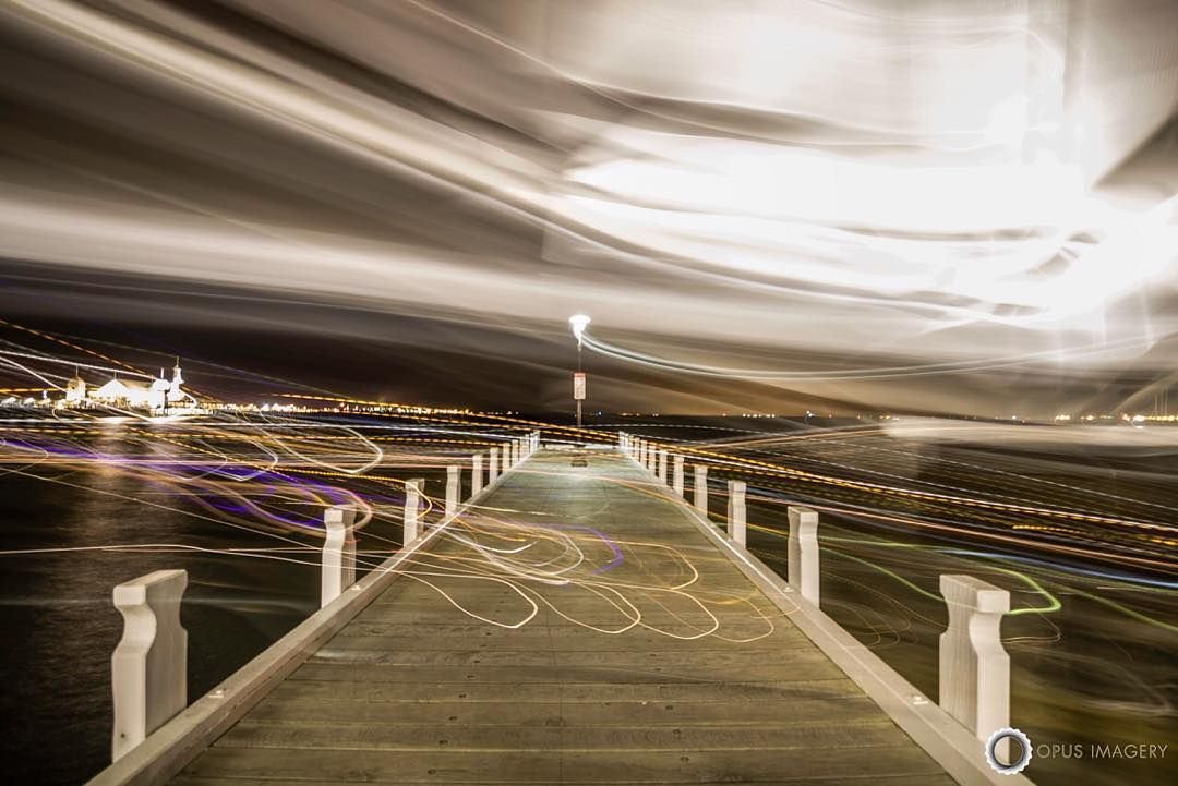 Was doing a 30 second exposure over the weekend during the thunderstorm when a drunken couple decided to go for a stroll on the pier during this shot. I picked up the tripod to relocate not realising that the exposure did not finish and this was the result.  #lazyshutters #geelongwaterfront #longexposure #accidentalart #geelong #instadaily #canon_photos #nightphotography #light #color #wanderlust #geelongphotographer #Ig_Australia #justgoshoot #movement #photogram by opusimagery…