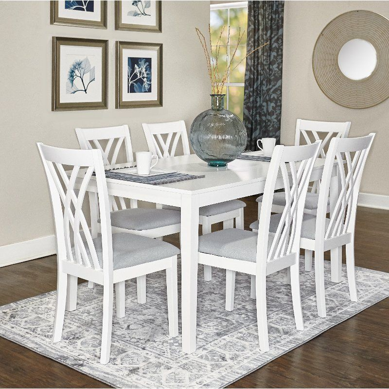 With The Open And Airy Design Of The Dining Chairs And Smooth And Glossy White Finish Of The Dining T 7 Piece Dining Set White Dining Room Sets Nook Dining Set