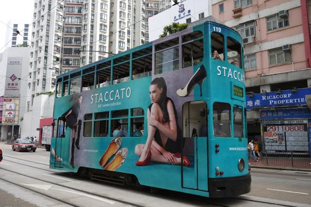 Tram in Hong Kong with California Pizza Kitchen advertising Read
