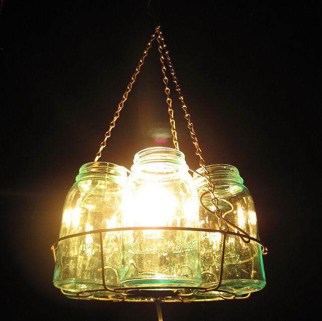 Mason Jar Chandelier With Antique Canning Rack Outdoors