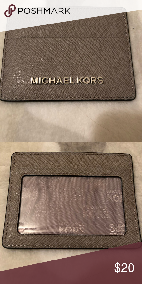 7dca8bde512d Michael Kors pocket wallet Michael Kors pocket wallet is in excellent  condition. Used twice! Nothing wrong with it just not being used!