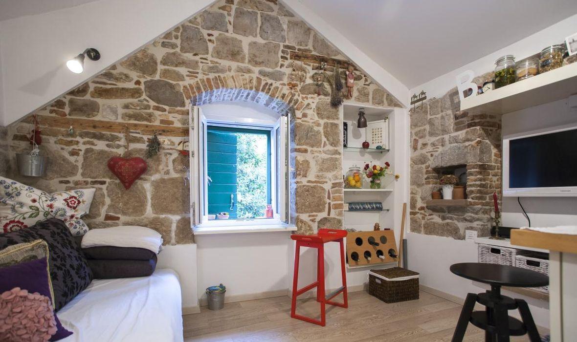 live in 18 sqm attic studio apartment