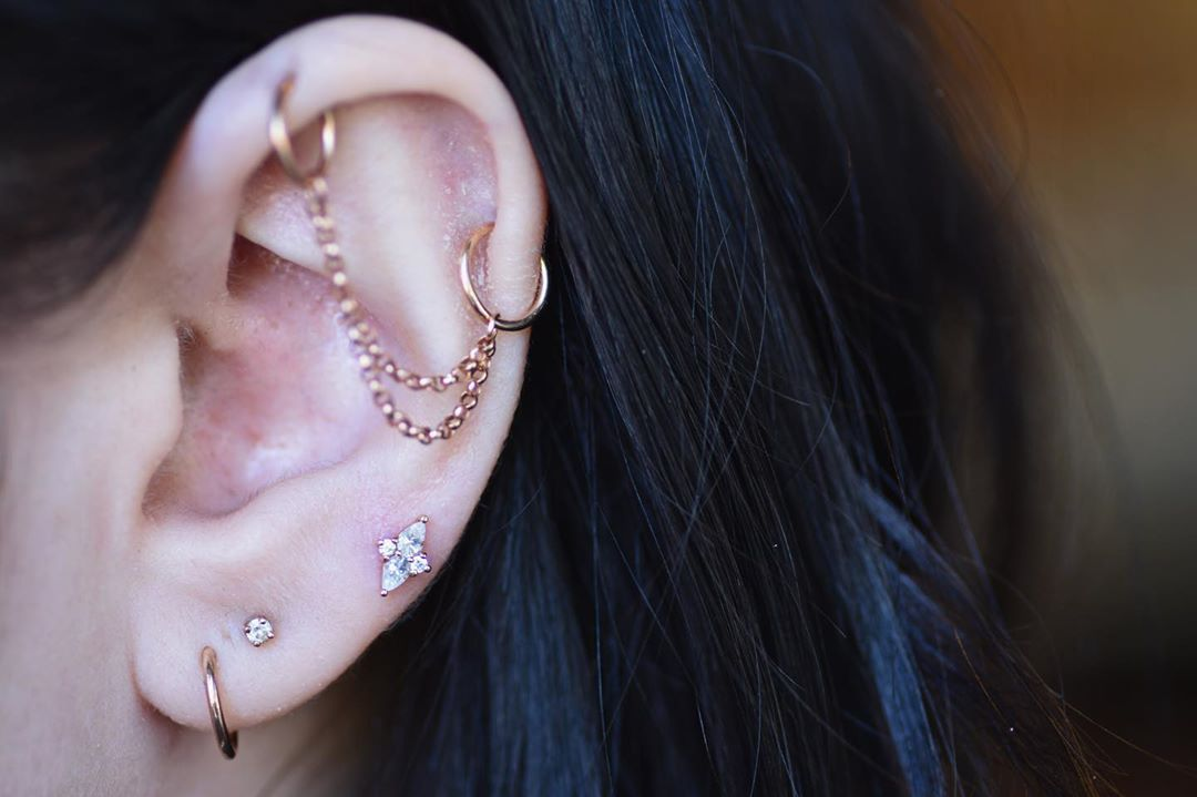 Identity On Instagram Check Out This Fresh Nook Piercing With A Beautiful Ethereal End This Stunning Design Is Ava Constellation Piercings Piercing Ear Cuff