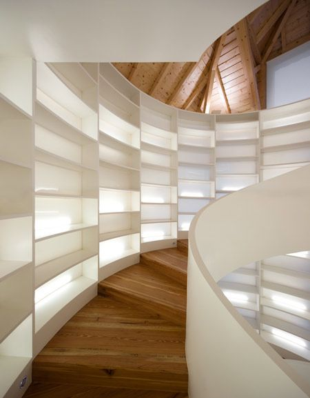 This one holds 6,000 books - finally, I could house my tomes!  Creative and Modern Staircase Designs (15) 9