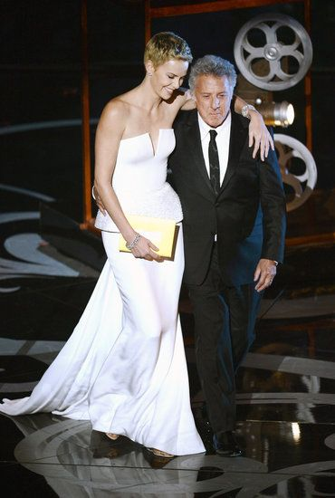 See All the Pictures Inside the Oscars: Charlize Theron hugged Dustin Hoffman at the 2013 Oscars.