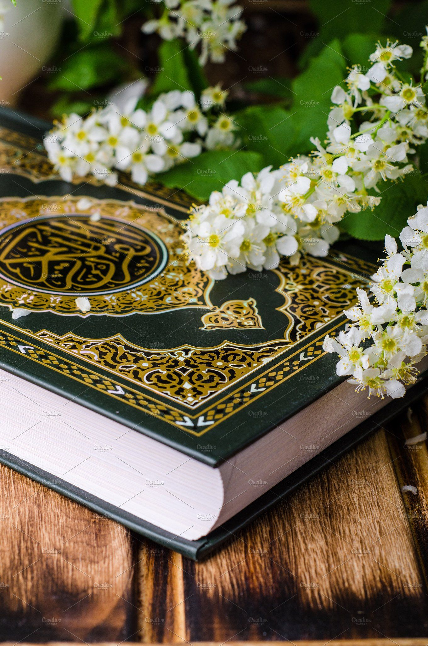 Quran Holly Book Of Islam With Spring Flowers And Blue Scarf On Wooden Background Selective Focus On Book Islamic Wallpaper Quran Book Quran Wallpaper