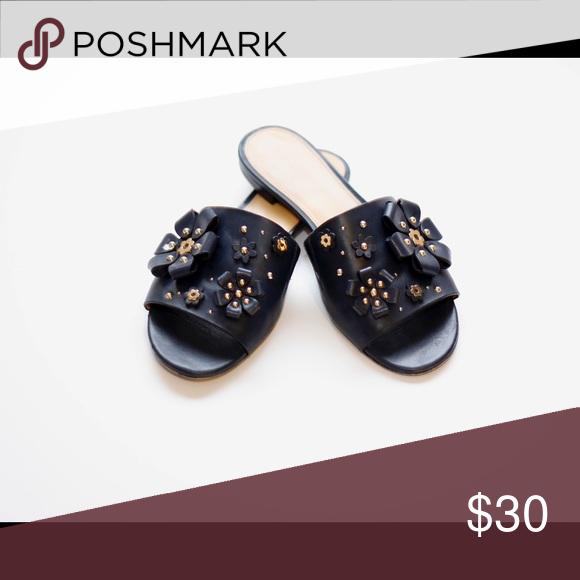 5daeabd9c8259 Tara Floral Embellished Leather Slide Effortless feminine charm. Detailed  with floral appliqués and gilded embellishments. Color is Navy Michael Kors  Shoes ...