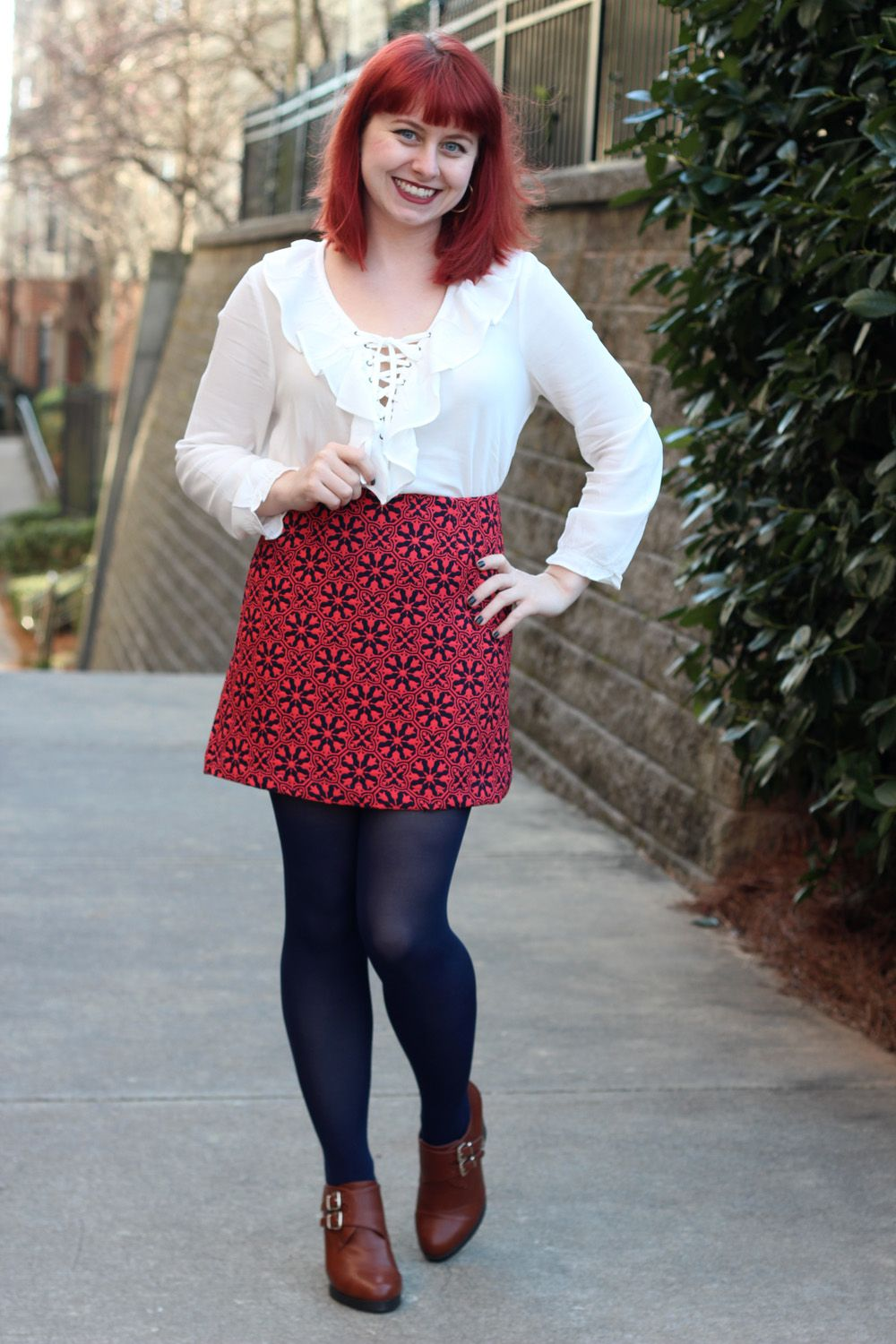 a5c83e005a Retro Lace Up White Blouse with a Geometric Floral Mini Skirt, Navy Blue  Tights, and Tall Tawny Brown Ankle Boots
