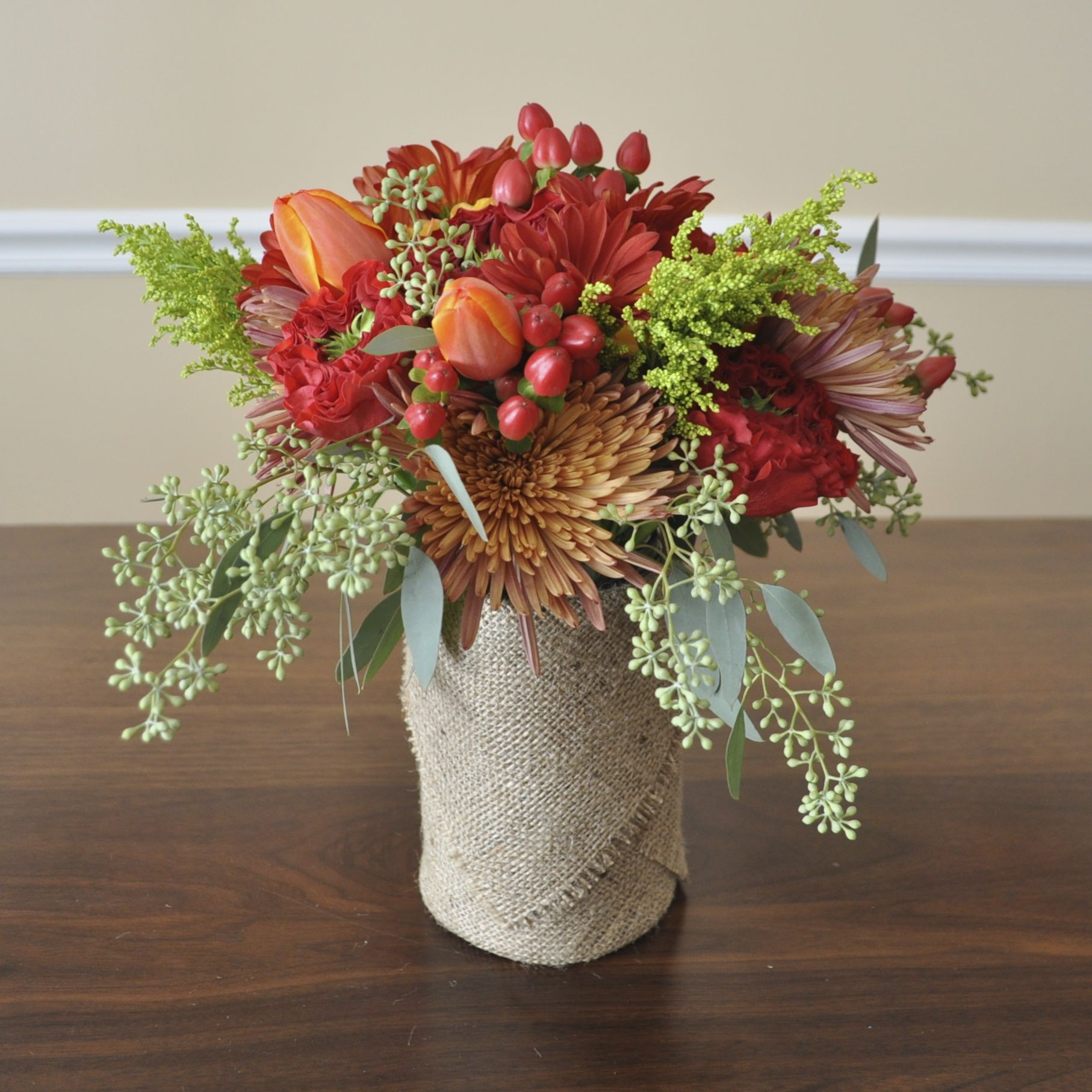 Flower bouquet of fall colors in a mason jar with images