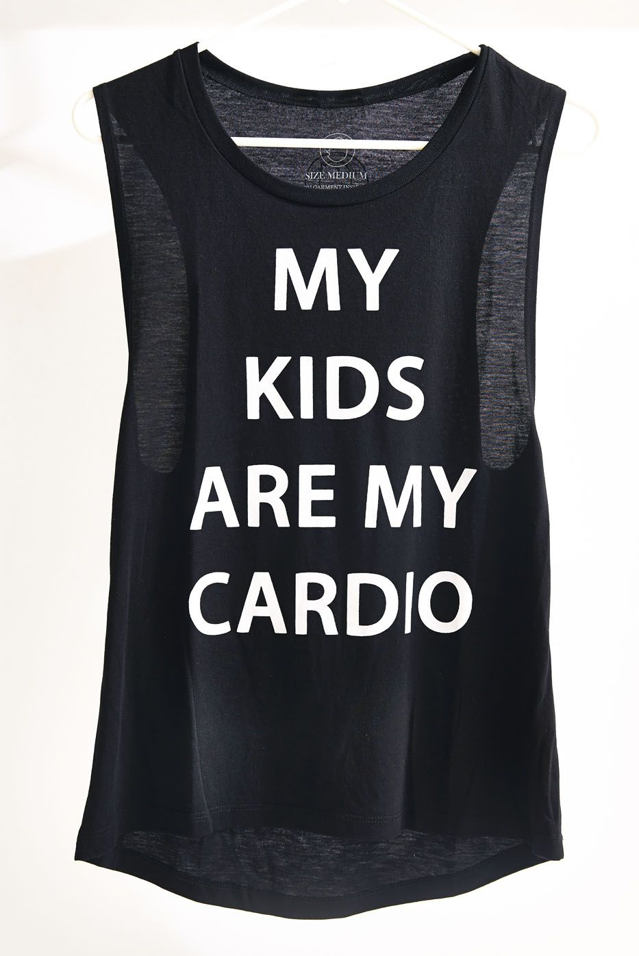 While chasing the kids and getting your workout in, look stylish in this super soft tank! Available at www.baby-chick.com.