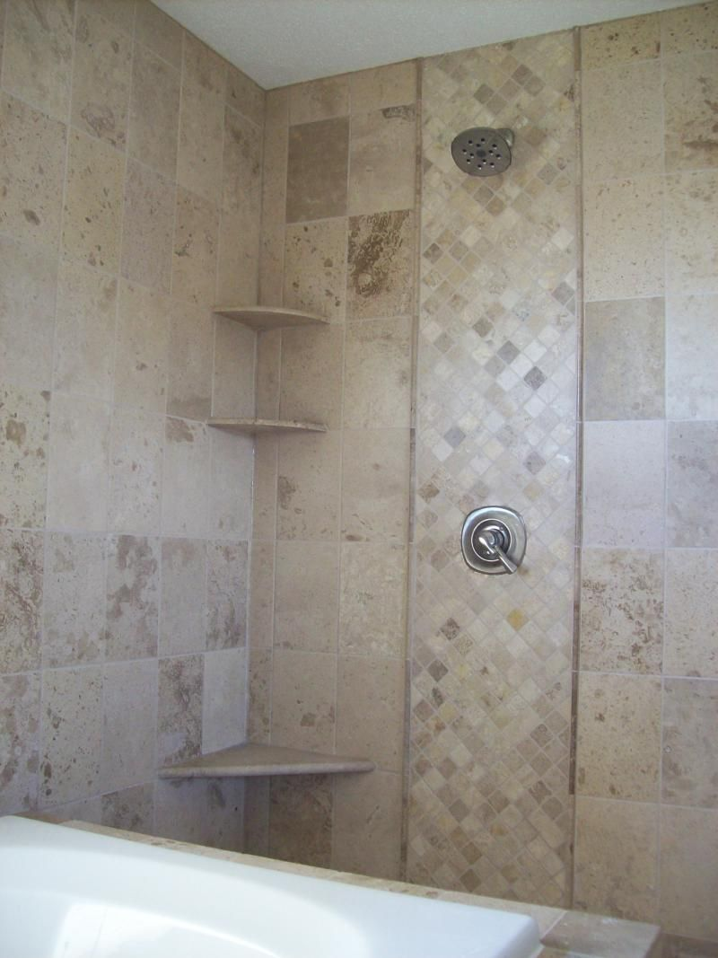 Mosaic tile accent strip in tile shower installed by a St ...