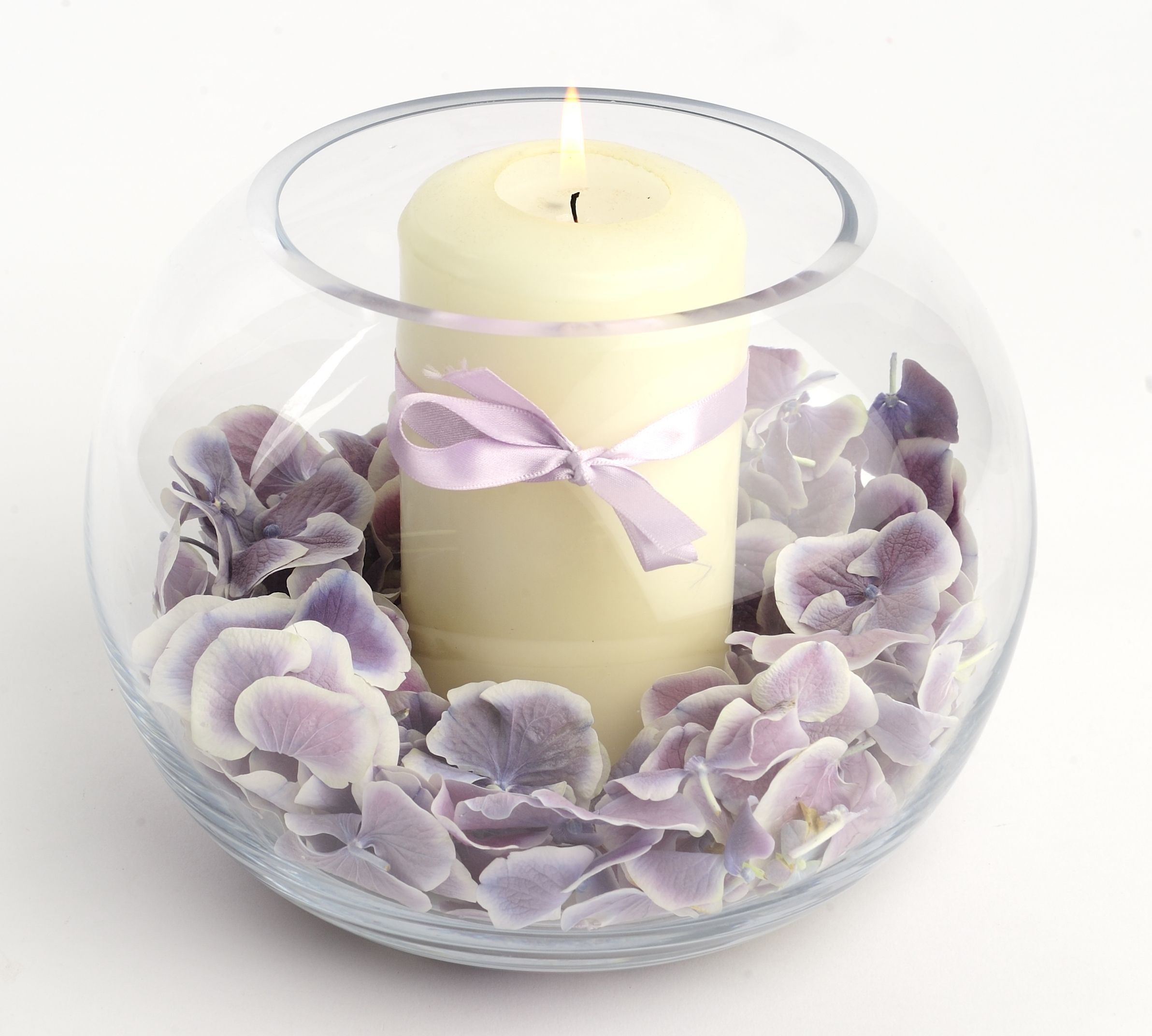 Use wisteria petals as a decorative addition to your candle holder ...