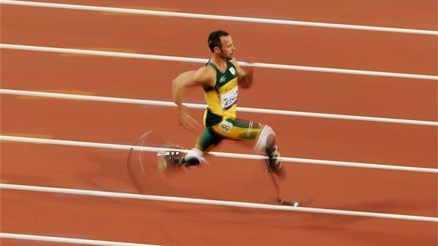 Oscar Pistorius of South Africa breaks the world record