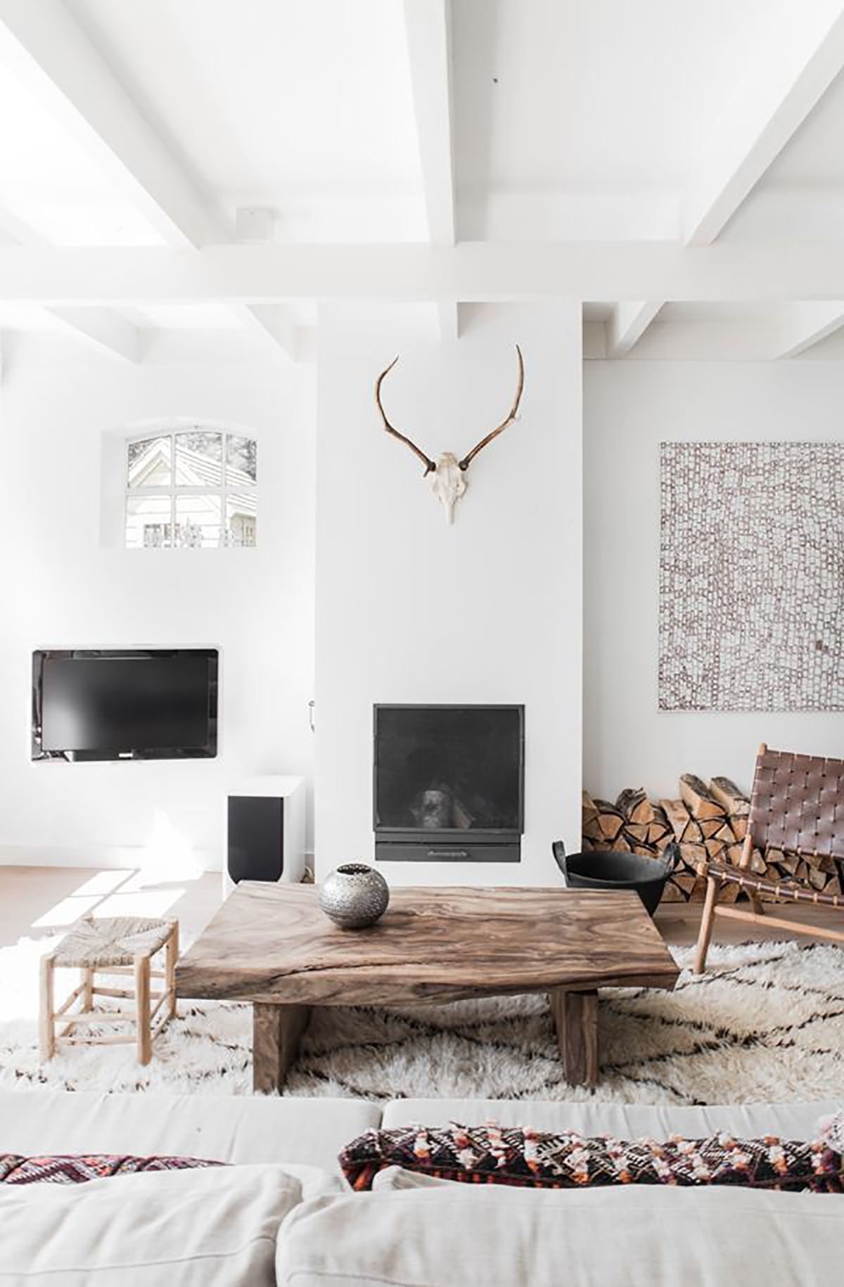 Pretty plush Moroccan shag rug in a modern Scandinavian living room ...